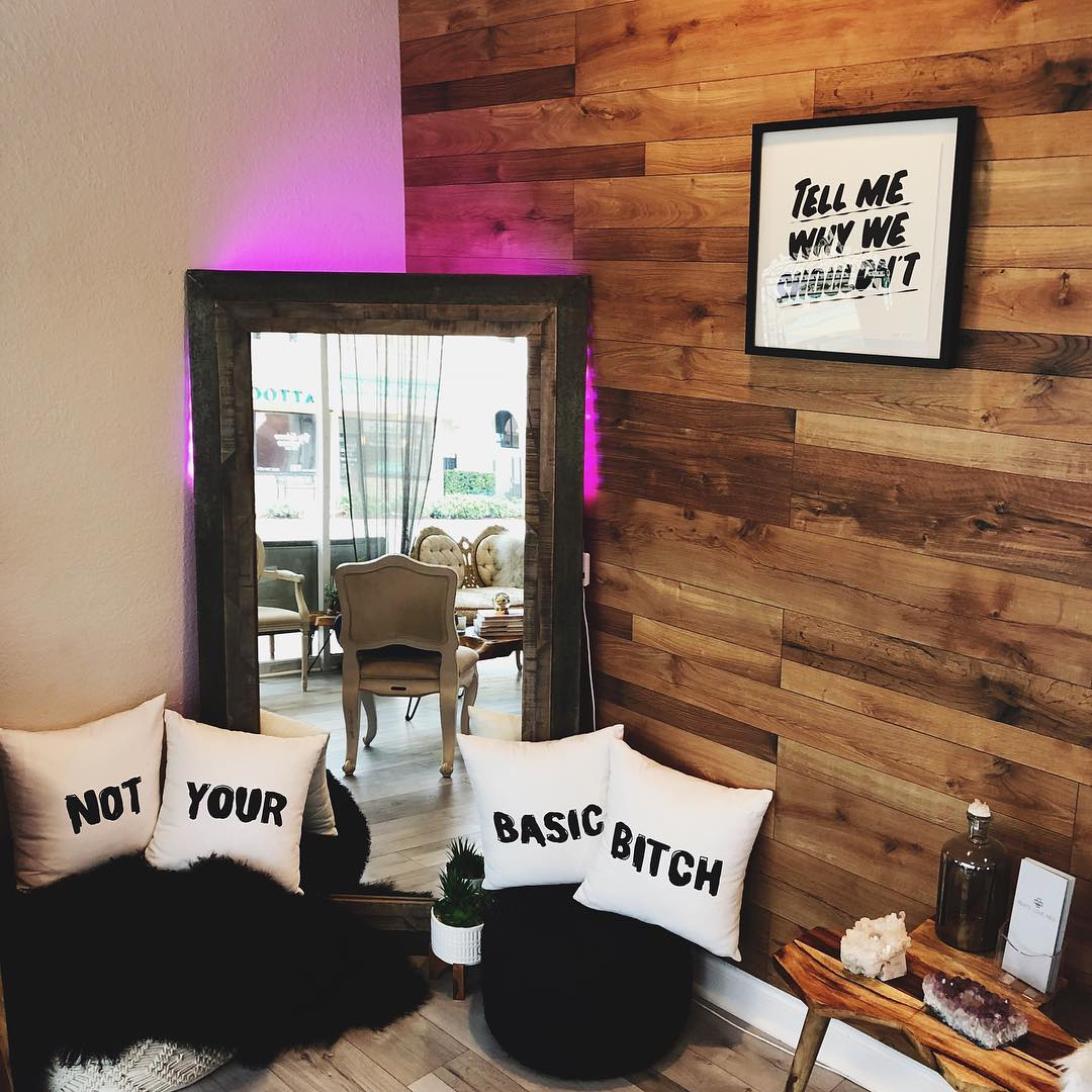 an image of a room with a mirror and a lot of pillows with catch phrases